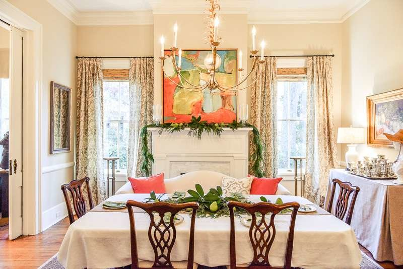 Twist on Christmas dining room decor, garland with pears, coral pillows and accents