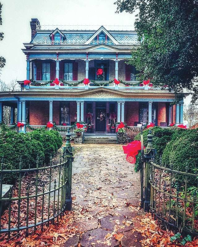 Old fashioned Christmas at this historic home. Iron gate, large front porch and Victorian details