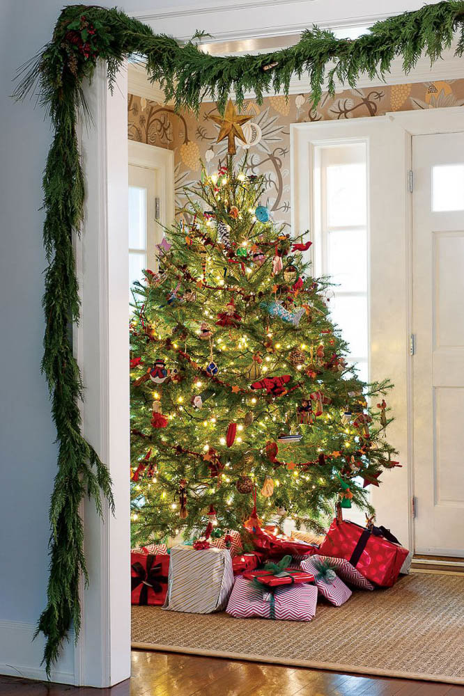 Outlining arches and entryways with lush greenery and garland for Christmas | Cottages and Bungalows