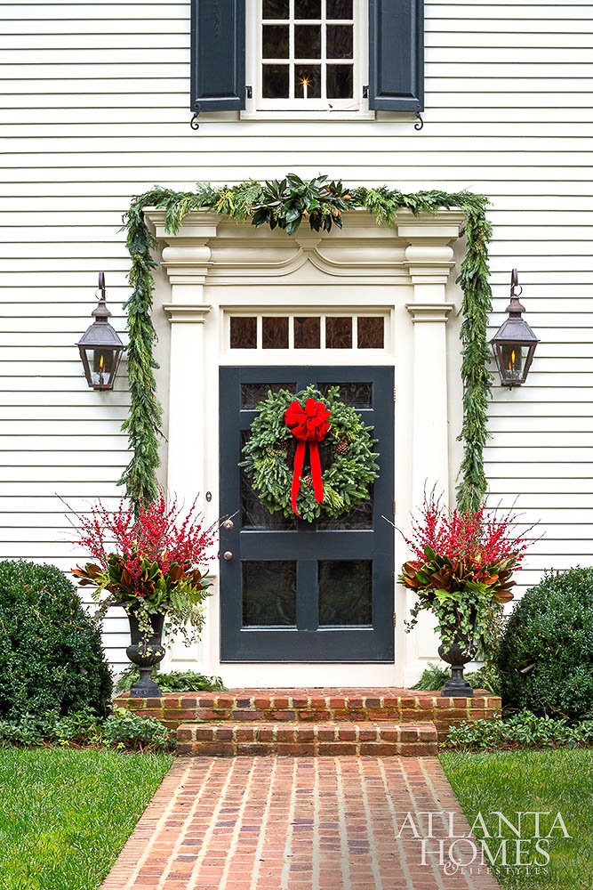 Simple holiday decor featuring front door wreath and garland decorations for Christmas | Atlanta Homes