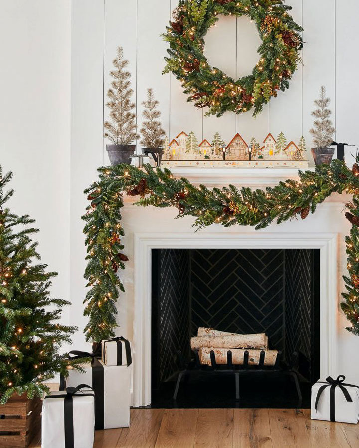 A simple and rustic mantel and fireplace for Christmas with pre-wrapped gifts | ways to decorate for the holidays by Cottages and Bungalows