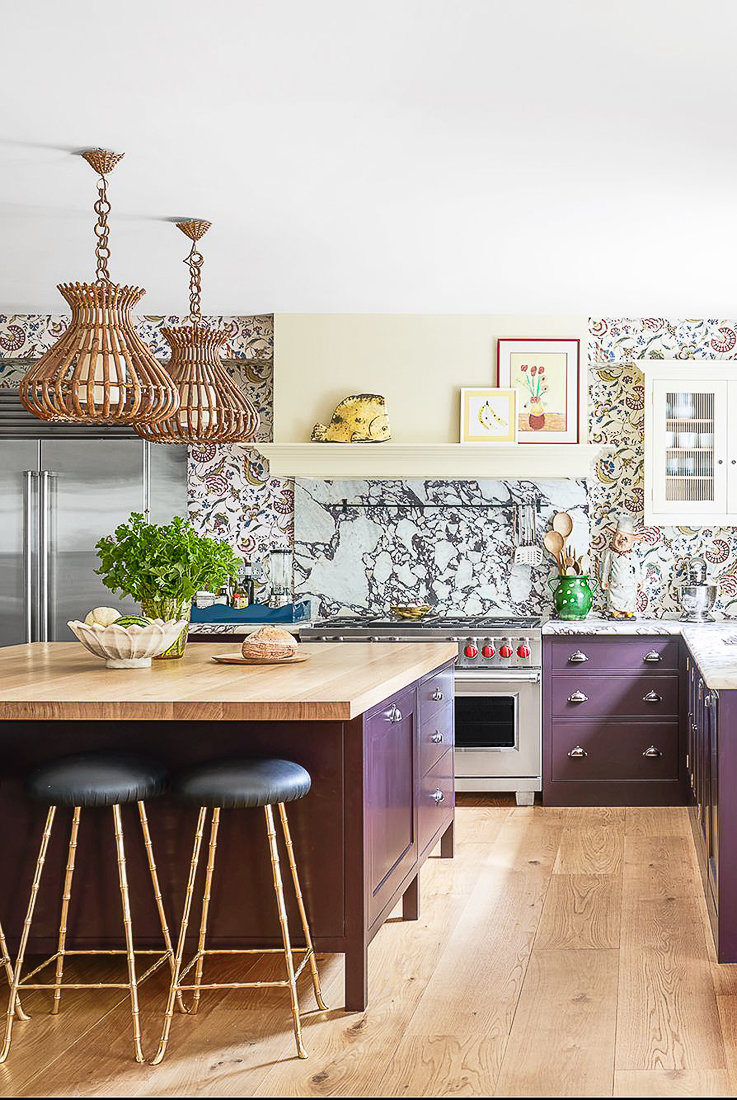 Gorgeous abstract and bright kitchen with plum painted cabinets and adventurous wallpaper backsplash