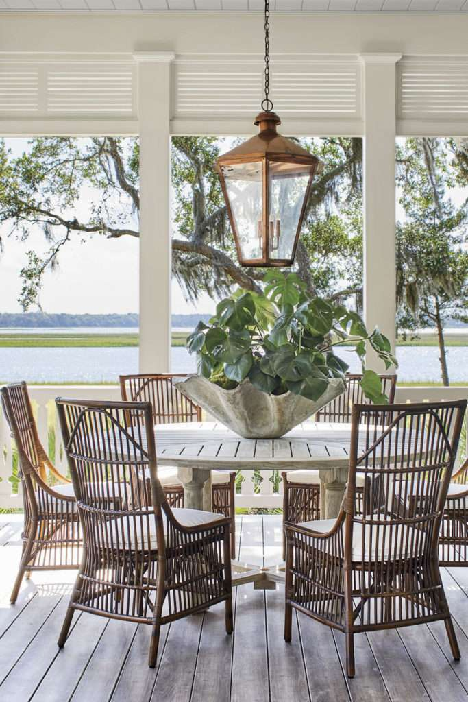 Outdoor dining featuring wicker furniture and natural colors that blend with nature