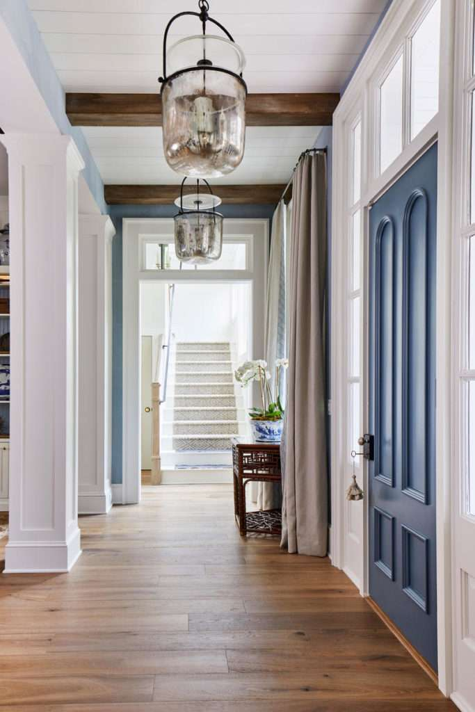 Tongue and groove ceiling painted white, blue and white contrasting interior paint.